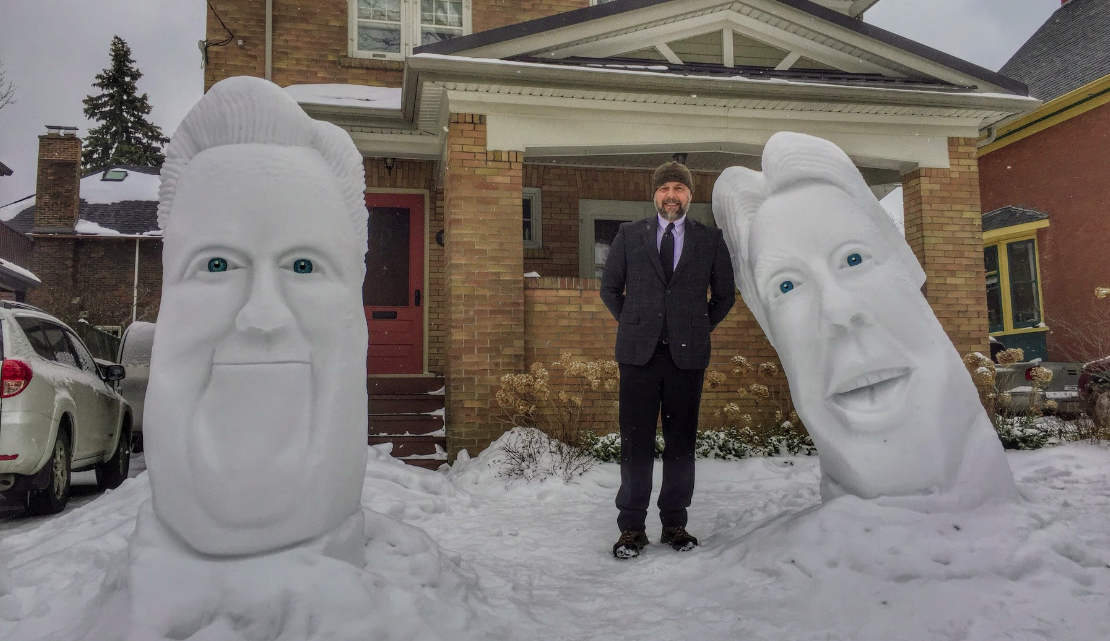 Matt Morris with his giant head snow sculptures
